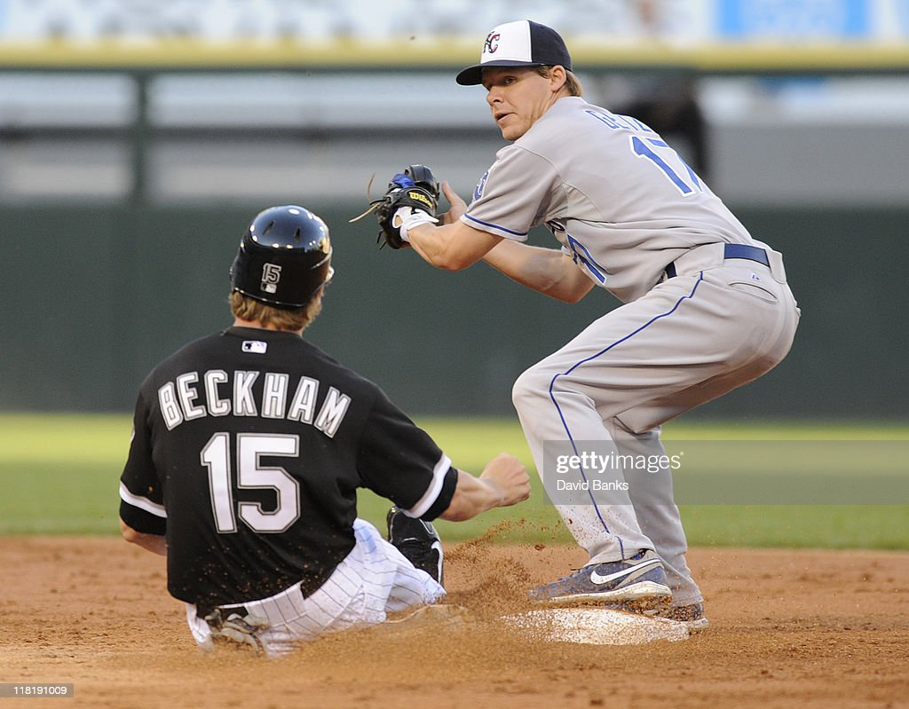 <a gi-track='captionPersonalityLinkClicked' href=/galleries/search?phrase=Gordon+Beckham&family=editorial&specificpeople=5411079 ng-click='$event.stopPropagation()'>Gordon Beckham</a> #15 of the Chicago White Sox is forced out by <a gi-track='captionPersonalityLinkClicked' href=/galleries/search?phrase=Chris+Getz&family=editorial&specificpeople=4936717 ng-click='$event.stopPropagation()'>Chris Getz</a> #17 of the Kansas City Royals on July 4, 2011 at U.S. Cellular Field in Chicago, Illinois.