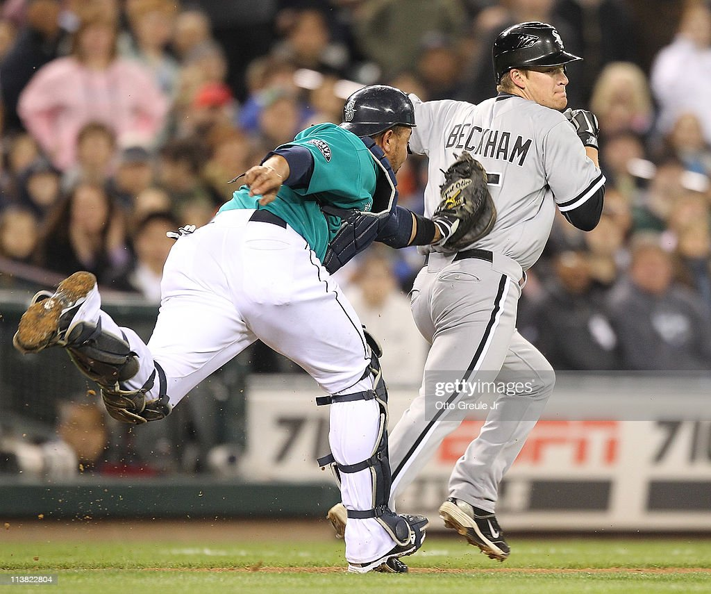 <a gi-track='captionPersonalityLinkClicked' href=/galleries/search?phrase=Gordon+Beckham&family=editorial&specificpeople=5411079 ng-click='$event.stopPropagation()'>Gordon Beckham</a> #15 of the Chicago White Sox is tagged out in a run down between third and home in the eighth inning by catcher <a gi-track='captionPersonalityLinkClicked' href=/galleries/search?phrase=Miguel+Olivo&family=editorial&specificpeople=209185 ng-click='$event.stopPropagation()'>Miguel Olivo</a> #30 of the Seattle Mariners at Safeco Field on May 6, 2011 in Seattle, Washington.