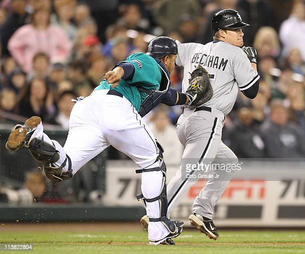 Gordon Beckham of the Chicago White Sox is tagged out in a run down between third and home in the eighth inning by catcher Miguel Olivo of the...