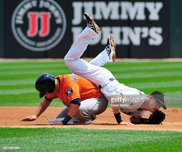 Gordon Beckham of the Chicago White Sox is upended after forcing out Enrique Hernandez of the Houston Astros during the first inning on July 20 2014...