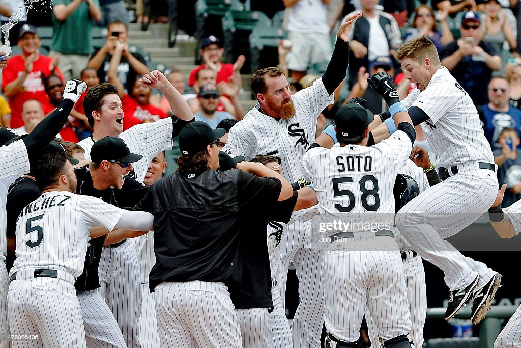 Gordon Beckham of the Chicago White Sox leaps into the air as he laands on home plate after hitting a walkoff home run against the Texas Rangers...