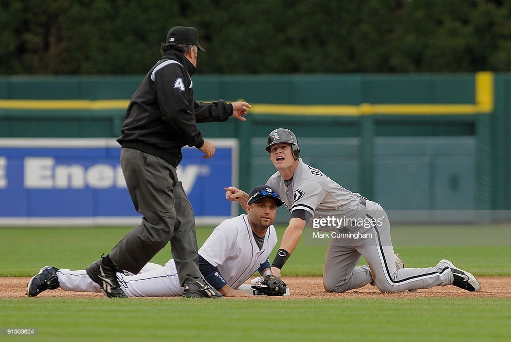 Gordon Beckham of the Chicago White Sox looks up in disbelief as Major League umpire Tim Tschida calls him out at second base after being tagged by...