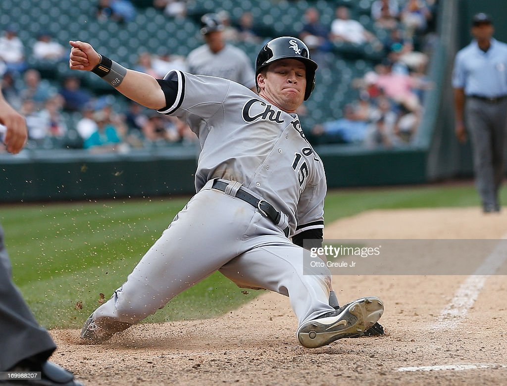 <a gi-track='captionPersonalityLinkClicked' href=/galleries/search?phrase=Gordon+Beckham&family=editorial&specificpeople=5411079 ng-click='$event.stopPropagation()'>Gordon Beckham</a> #15 of the Chicago White Sox scores on an RBI single by Alejandro De Aza in the sixteenth inning against the Seattle Mariners at Safeco Field on June 5, 2013 in Seattle, Washington.