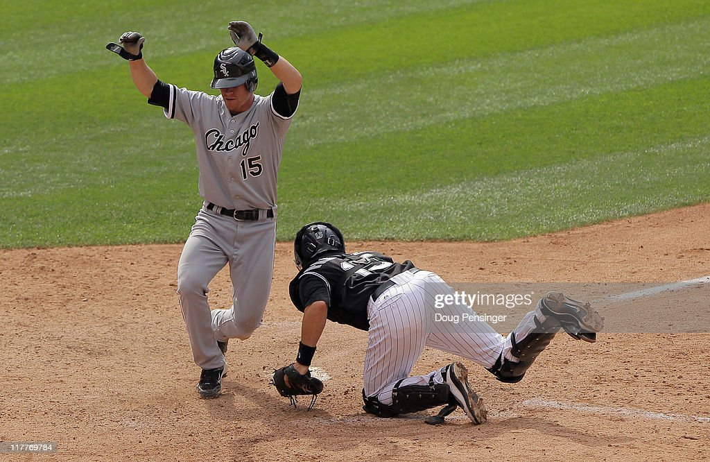 <a gi-track='captionPersonalityLinkClicked' href=/galleries/search?phrase=Gordon+Beckham&family=editorial&specificpeople=5411079 ng-click='$event.stopPropagation()'>Gordon Beckham</a> #15 of the Chicago White Sox slides home with an insurance run ahead of the tag by catcher Matt Pagnozzi #15 of the Colorado Rockies on a two RBI game winning single by Juan Pierre of the White Sox in the 10th inning during Interleague play at Coors Field on June 30, 2011 in Denver, Colorado. The White Sox defeated the Rockies 6-4.