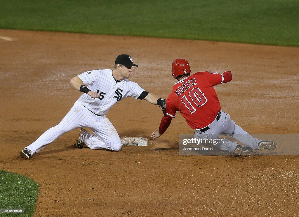Gordon Beckham #15 of the Chicago White Sox tags out Grant Green #10 of the Los Angeles Angels of Anaheim as he tries to steal in the 9th inning at U.S. Cellular Field on July 2, 2014 in Chicago, Illinois. The White Sox defeated the Angels 3-2.