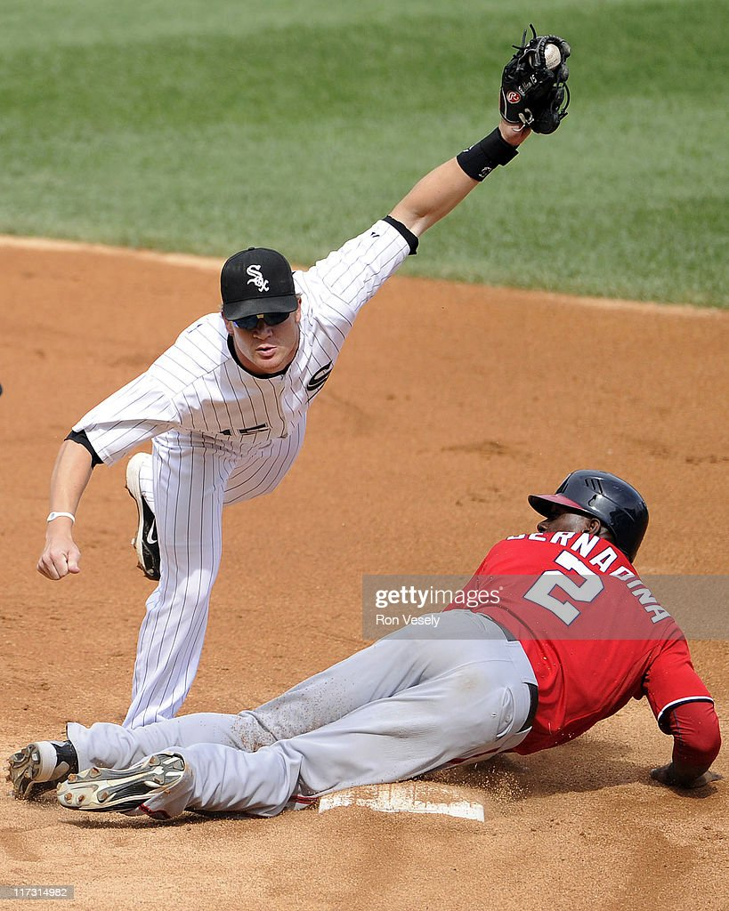 <a gi-track='captionPersonalityLinkClicked' href=/galleries/search?phrase=Gordon+Beckham&family=editorial&specificpeople=5411079 ng-click='$event.stopPropagation()'>Gordon Beckham</a> #15 of the Chicago White Sox tags out Roger Bernadina #2 of the Washington Nationals while attempting to steal second base in the third inning on June 25, 2011 at U.S. Cellular Field in Chicago, Illinois.
