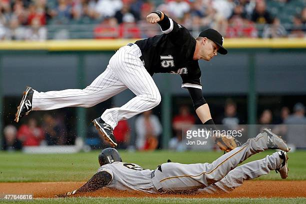 Gordon Beckham of the Chicago White Sox tags out Starling Marte of the Pittsburgh Pirates on an attemp to steal second base during the first inning...