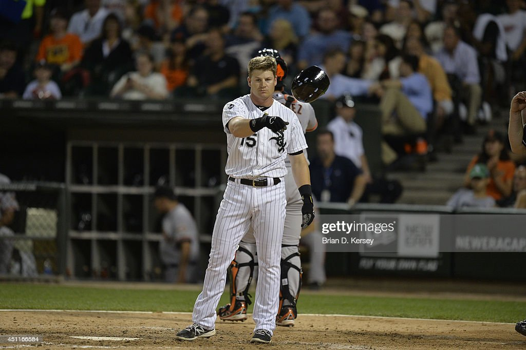 Gordon Beckham #15 of the Chicago White Sox throws his helmet after striking out during the sixth inning against the San Francisco Giants at U.S. Cellular Field on June 17, 2014 in Chicago, Illinois. The White Sox defeated the Giants 8-2.