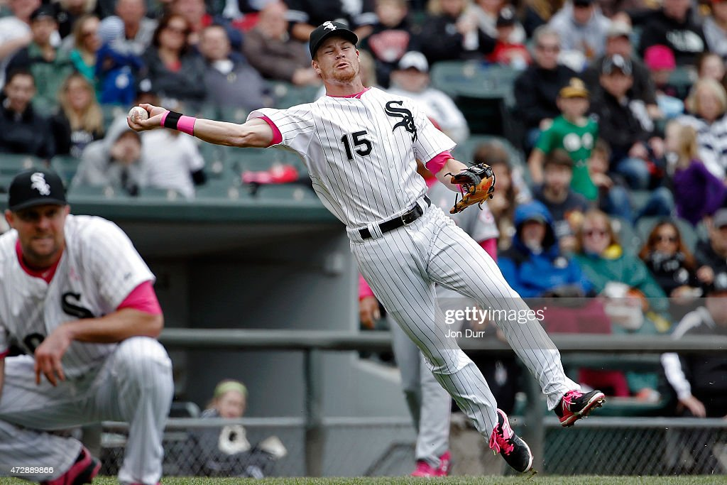 Gordon Beckham #15 of the Chicago White Sox throws to first base against the Cincinnati Reds during the seventh inning on May 10, 2015 at U.S. Cellular Field in Chicago, Illinois. The Chicago White Sox won 4-3.