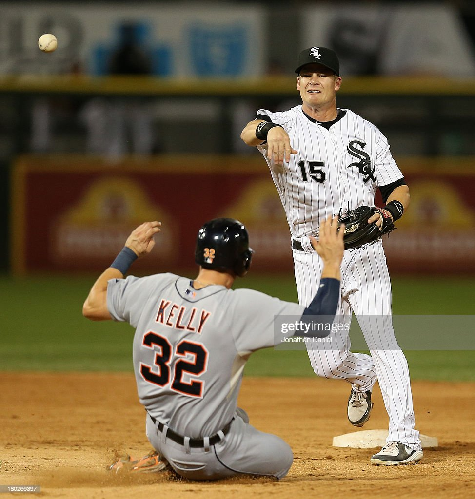 <a gi-track='captionPersonalityLinkClicked' href=/galleries/search?phrase=Gordon+Beckham&family=editorial&specificpeople=5411079 ng-click='$event.stopPropagation()'>Gordon Beckham</a> #15 of the Chicago White Sox turns a double play in the 7th inning as Don Kelly #32 of the Detroit Tigers slides in at U.S. Cellular Field on September 10, 2013 in Chicago, Illinois.