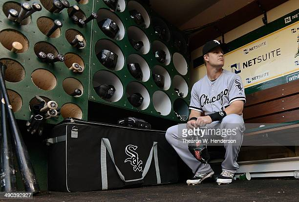Gordon Beckham of the Chicago Whites Sox sitting in front of the helmet and bat rack in the dugout prior to the start of his game against the Oakland...