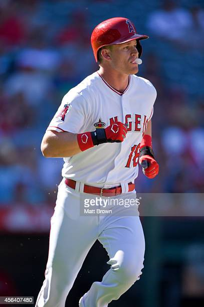 Gordon Beckham of the Los Angeles Angels of Anaheim blows a bubble with his gum while running during the game against the Texas Rangers on September...