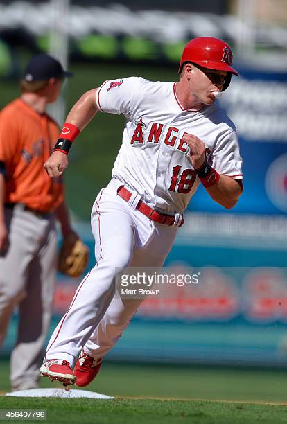 Gordon Beckham of the Los Angeles Angels of Anaheim blows a bubble with his gum while running during the game against the Houston Astros on September...