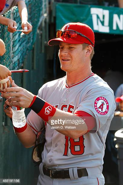 Gordon Beckham of the Los Angeles Angels of Anaheim signs autographs outside the dugout before the game against the Oakland Athletics at Oco Coliseum...