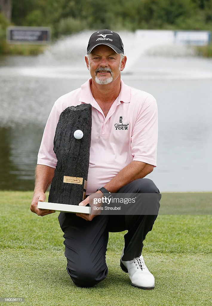 Gordon Brand Junior of Scotland poses with the trophy after winning the WINSTONgolf Senior Open played at WINSTONgolf on September 8, 2013 in Schwerin, Germany.