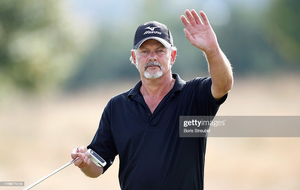 Gordon Brand Junior of Scottland waves to his fans during the second round on day two of the WINSTONgolf Senior Open played at WINSTONgolf on September 7, 2013 in Schwerin, Germany.