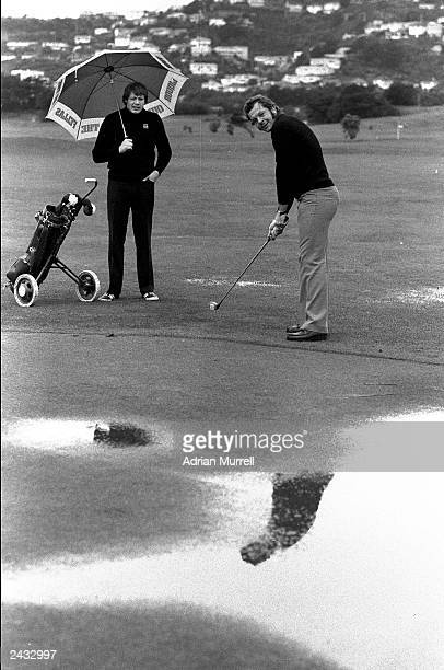 Gordon Brown and Bill Beaumont of the Lions play golf during the British Lions tour 1977 in New Zealand