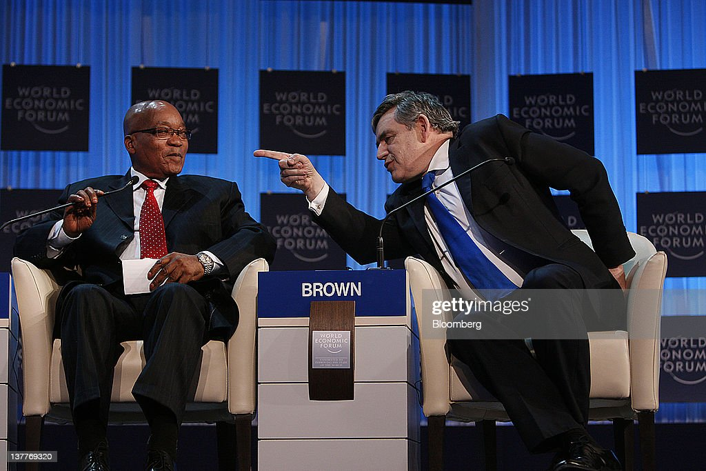 Gordon Brown, former U.K. prime minister, right, speaks with Jacob Zuma, president of South Africa, during a session on day two of the World Economic Forum (WEF) in Davos, Switzerland, on Thursday, Jan. 26, 2012. The 42nd annual meeting of the World Economic Forum will be attended by about 2,600 political, business and financial leaders at the five-day conference. Photographer: Scott Eells/Bloomberg via Getty Images