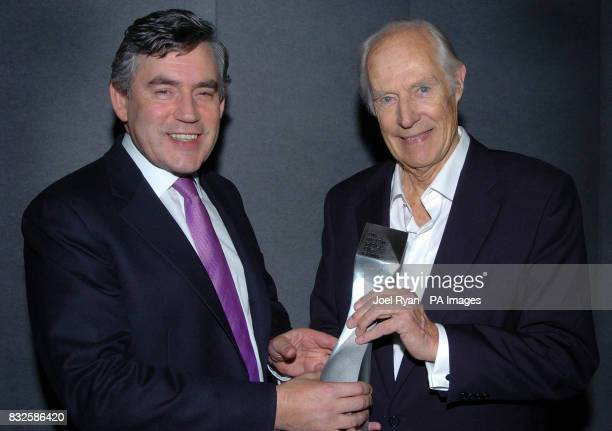 Gordon Brown presents George Martin with the award to mark the latter's induction into the UK Hall of Fame at the UK Music Hall of Fame 2006 in...