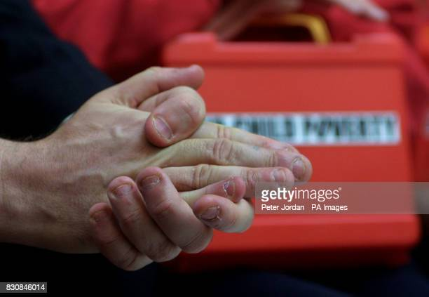 Gordon Brown's finger nails are bitten down against the backdrop of a toy plastic Budget box during a visit to Number 11 Downing Street by school...