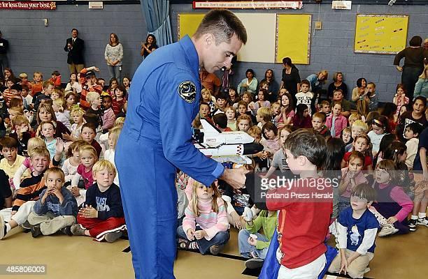 Gordon Chibroski/Staff Photographer Astronaut Chris Cassidy borrows a model space shuttle from kindergartner Gavin Tucker at Village Elementary...