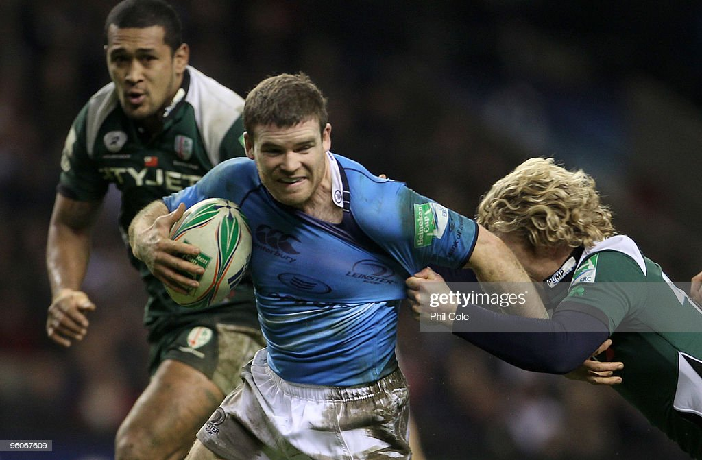 Gordon D'arcy of Leinster gets tackled by <a gi-track='captionPersonalityLinkClicked' href=/galleries/search?phrase=Peter+Richards&family=editorial&specificpeople=209400 ng-click='$event.stopPropagation()'>Peter Richards</a> of London Irish during the Heineken Cup Pool Six game between London Irish and Leinster at Twickenham on January 23, 2010 in Twickenham, England.