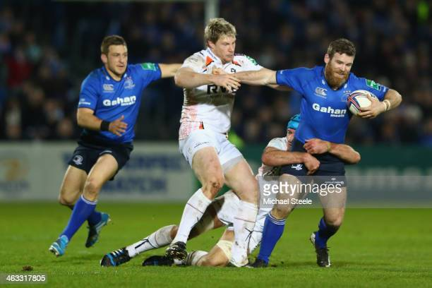 Gordon D'Arcy of Leinster holds off Jonathan Spratt of Ospreys during the Heineken Cup Pool One match between |Leinster and Ospreys at the Royal...