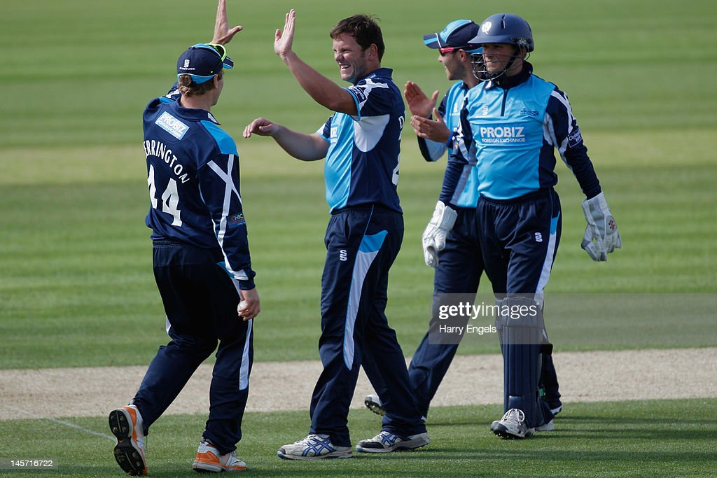 Gordon Drummond of Scotland celebrates with teammates after taking a wicket during the Clydesdale Bank Pro40 match between the Hampshire Royals and the Scottish Saltires on June 4, 2012 in Southampton, England.