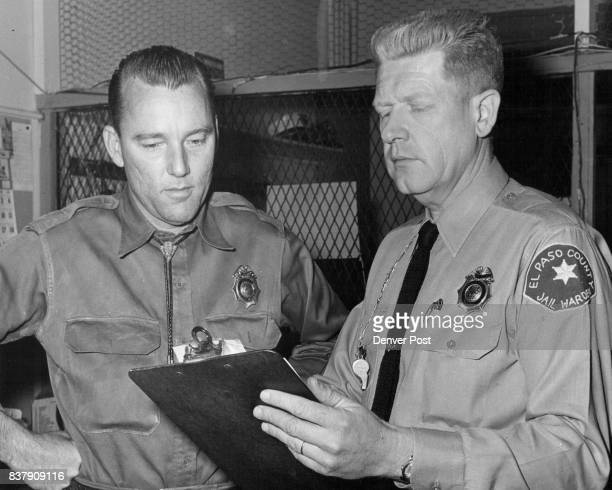 Gordon E Pennington right warden of the El Paso county jail with one of the jailers Cecil M Barrett Many improvements to the jail have been made...