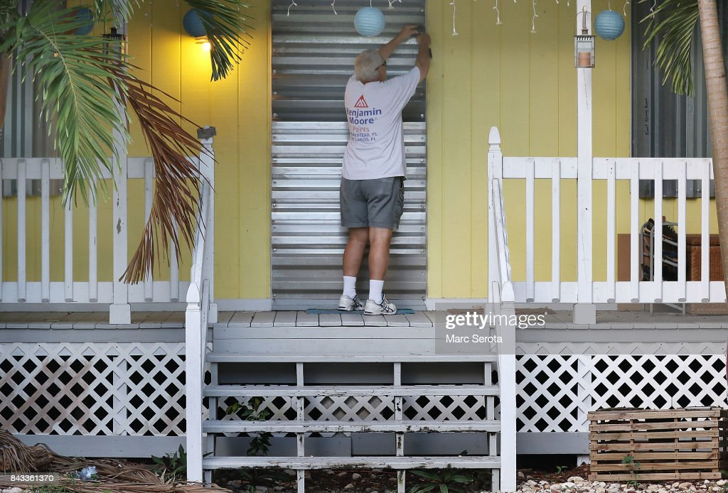 Gordon Forget installs hurricane shutters to a house in the Florida Keys on September 6, 2017 in Islamorada, Florida. Hurricane Irma has grown to a category 5 storm and is expected to make landfall in the Florida Keys this weekend.
