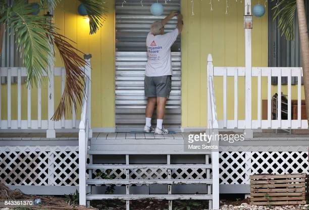 Gordon Forget installs hurricane shutters to a house in the Florida Keys on September 6 2017 in Islamorada Florida Hurricane Irma has grown to a...