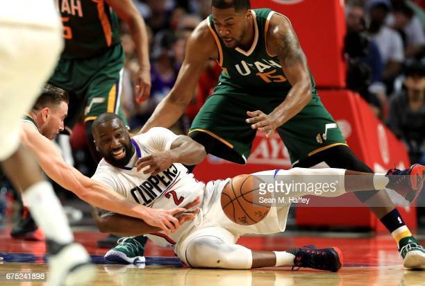 Gordon Hayward and Derrick Favors of the Utah Jazz battle Raymond Felton of the Los Angeles Clippers for a loose ball during the second half of Game...