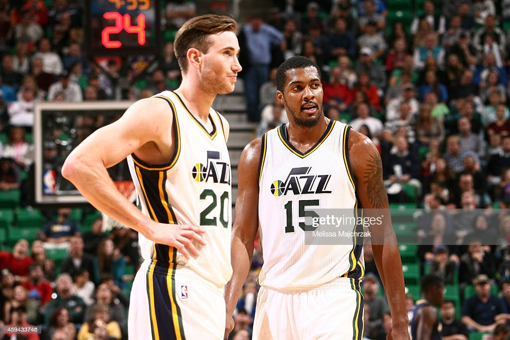 Gordon Hayward and Derrick Favors of the Utah Jazz stand on the court during a game against the New Orleans Pelicans at EnergySolutions Arena on...