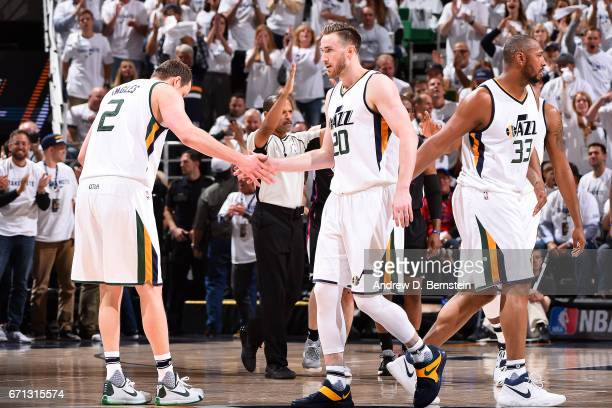 Gordon Hayward and Joe Ingles of the Utah Jazz high five each other during the game against the Los Angeles Clippers during the Western Conference...