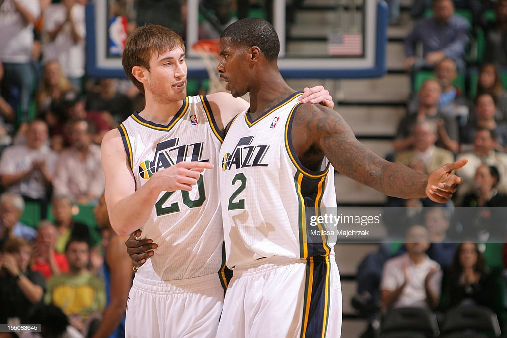 Gordon Hayward #20 and Marvin Williams #2 of the Utah Jazz during a timeout against the Dallas Mavericks at Energy Solutions Arena on October 31, 2012 in Salt Lake City, Utah.