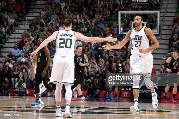 Gordon Hayward and Rudy Gobert of the Utah Jazz high five each other during the game against the Los Angeles Clippers on March 13 2017 at...