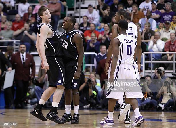 Gordon Hayward and Shelvin Mack of the Butler Bulldogs celebrate after Hayward hit a three point shot against the Kansas State Wildcats during the...