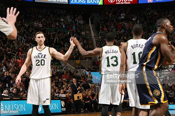 Gordon Hayward high fives teammate Elijah Millsap of the Utah Jazz during the game against the Indiana Pacers on December 5 2015 at Vivint Smart Home...