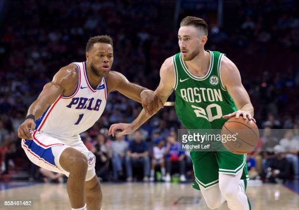 Gordon Hayward of the Boston Celtics drives to the basket against Justin Anderson of the Philadelphia 76ers in the first quarter of the preseason...