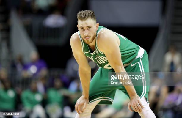 Gordon Hayward of the Boston Celtics watches on against the Charlotte Hornets during their game at Spectrum Center on October 11 2017 in Charlotte...
