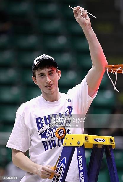 Gordon Hayward of the Butler Bulldogs celebrates after cutting down the net and defeating the Kansas State Wildcats in the west regional final of the...
