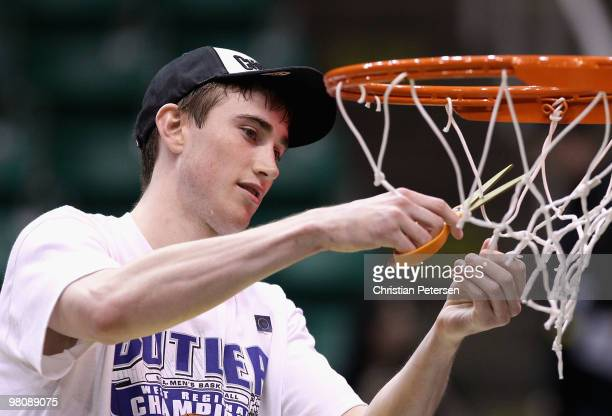 Gordon Hayward of the Butler Bulldogs cuts down the net after defeating the Kansas State Wildcats in the west regional final of the 2010 NCAA men's...