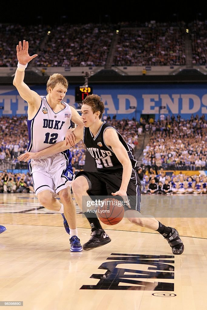 Gordon Hayward of the Butler Bulldogs drives against Kyle Singler of the Duke Blue Devils during the 2010 NCAA Division I Men's Basketball National...