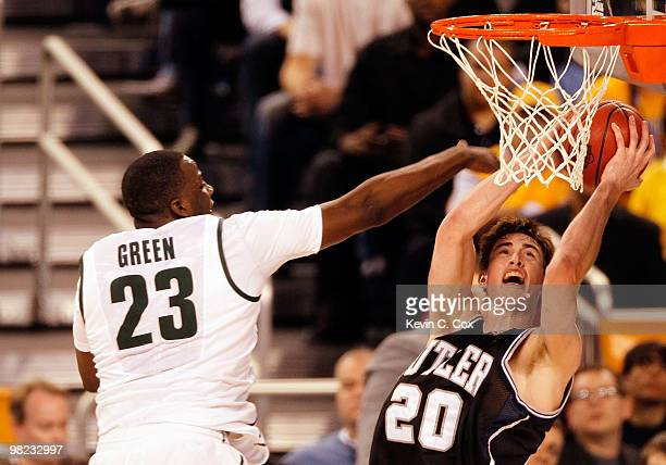Gordon Hayward of the Butler Bulldogs goes up for a shot against Draymond Green of the Michigan State Spartans in the second half during the National...