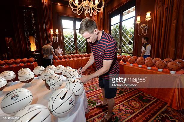 Gordon Hayward of the USA Basketball Men's National Team signs basketballs at the Wynn Las Vegas on July 27 2014 in Las Vegas Nevada NOTE TO USER...