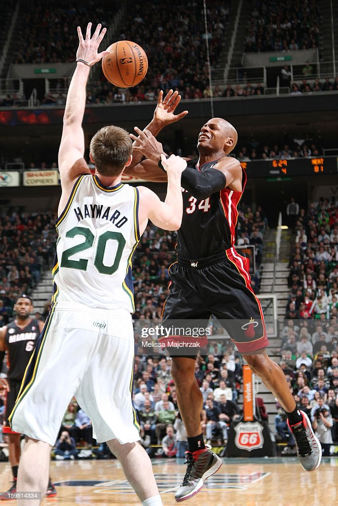 Gordon Hayward #20 of the Utah Jazz and Ray Allen #34 of the Miami Heat battle for the ball control at Energy Solutions Arena on January 14, 2013 in Salt Lake City, Utah.