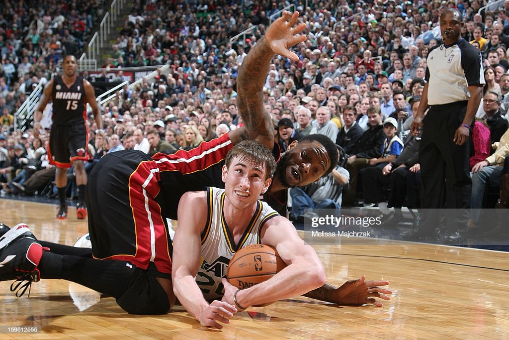 Gordon Hayward #20 of the Utah Jazz and Udonis Haslem #40 of the Miami Heat chase a loose ball at Energy Solutions Arena on January 14, 2013 in Salt Lake City, Utah.