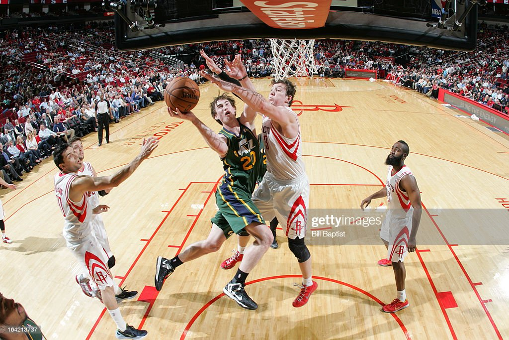 <a gi-track='captionPersonalityLinkClicked' href=/galleries/search?phrase=Gordon+Hayward&family=editorial&specificpeople=5767271 ng-click='$event.stopPropagation()'>Gordon Hayward</a> #20 of the Utah Jazz attempts a layup against <a gi-track='captionPersonalityLinkClicked' href=/galleries/search?phrase=Omer+Asik&family=editorial&specificpeople=4946055 ng-click='$event.stopPropagation()'>Omer Asik</a> #3 of the Houston Rockets on March 20, 2013 at the Toyota Center in Houston, Texas.