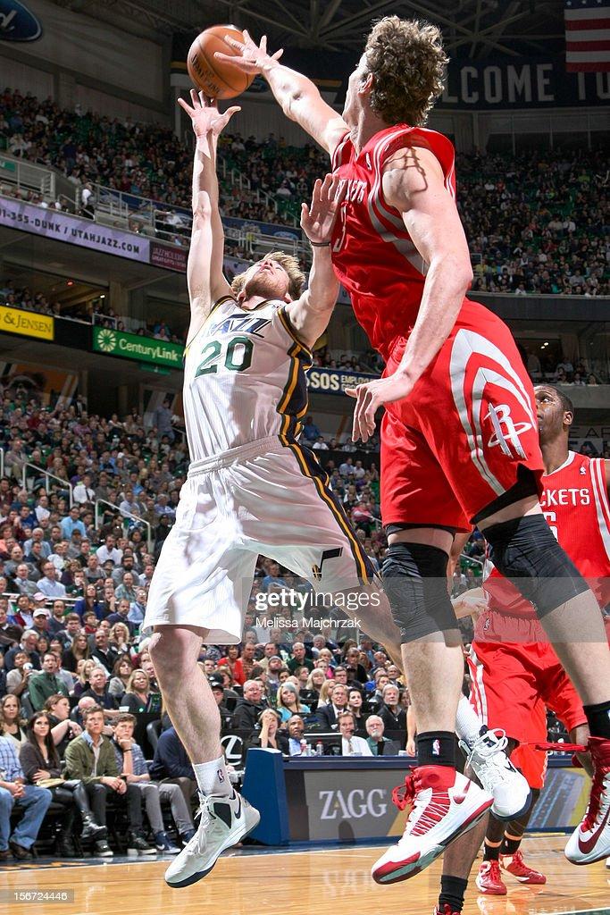 Gordon Hayward #20 of the Utah Jazz attempts a shot against Omer Asik #3 of the Houston Rockets at Energy Solutions Arena on November 19, 2012 in Salt Lake City, Utah.