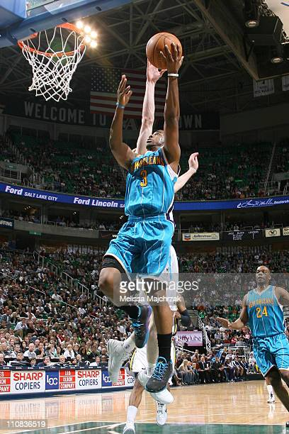 Gordon Hayward of the Utah Jazz blocks the shot of Chris Paul of the New Orleans Hornets at EnergySolutions Arena on March 24 2011 in Salt Lake City...